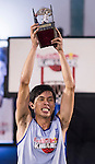 Huang of Taiwan celebrates with the trophy after winning the Red Bull King of the Rock National Finals at Kaohsiung University basketball court, Kaohsiung, Taiwan, on July 18th 2015.