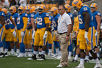Pitt head coach Pat Narduzzi (white shirt) watches his team warm up. The Pitt Panthers defeated the Georgia Tech Yellow Jackets 37-34 at Heinz Field in Pittsburgh, Pennsylvania on October 08, 2016.