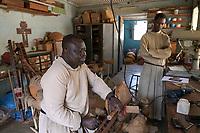 SENEGAL, Benedictine monastery Keur Moussa, monks work in workshop to build the african Kora bridge harp / Senegal, Benediktinerkloster Keur Moussa, Musikinstrumentbau, Werkstatt, Bau der Kora ein traditionelles westafrikanischen Saiteninstrument, Marie-Firmin Wade beim Instrument stimmen