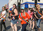 Reno Mayor Hillary Schieve, center, leads a group of participants during the Pride Parade in downtown Reno on Saturday, July 28, 2018.