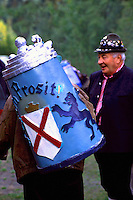 Oktoberfest Beer Festival, Whistler, BC, British Columbia, Canada - Happy Reveler singing and celebrating with Giant Beer Stein