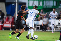 LAKE BUENA VISTA, FL - JULY 22: Florian Valot #22 of the New York Red Bulls and Kendall Waston #2 of FC Cincinnati battle for the ball during a game between New York Red Bulls and FC Cincinnati at Wide World of Sports on July 22, 2020 in Lake Buena Vista, Florida.