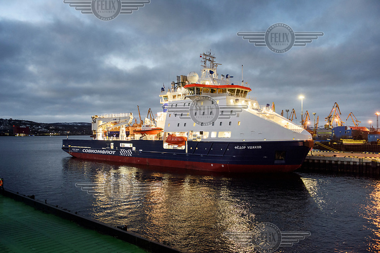 The 'Fedor Ushakov', a multifunctional ice-breaking vessel moored in Murmansk prior to its navigation along the Northern Sea Route. The ship is designed to provide the year-round delivery of supplies to offshore oil platforms operating in waters off Sakhalin, and standby assistance for emergency cases. The vessel is able to hold 150 passengers, sufficient in the case of a platform evacuation.