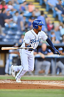 Asheville Tourists Daniel Montano (24) swings at a pitch during a game against the Charleston RiverDogs at McCormick Field on August 16, 2019 in Asheville, North Carolina. The Tourists defeated the RiverDogs 12-3. (Tony Farlow/Four Seam Images)