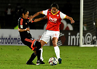 BOGOTA - COLOMBIA - 27 - 05 - 2017: Lady Andrade (Der.) jugadora de Independiente Santa Fe disputa el balón con Naila Imbachi (Izq.) jugadora de America de Cali, durante partido de vuelta por los cuartos de final entre Independiente Santa Fe y America de Cali, por la Liga Femenina Aguila 2017, en el estadio Nemesio Camacho El Campin de la ciudad de Bogota. / Lady Andrade (R) jugadora of Independiente Santa Fe struggles for the ball with Naila Imbachi (L) player of America de Cali, during a match of the second round of the  quarters of finals for the Liga Femenina Aguila 2017, between Independiente Santa Fe and America de Cali, at the Nemesio Camacho El Campin Stadium in Bogota city, Photo: VizzorImage / Luis Ramirez / Staff.
