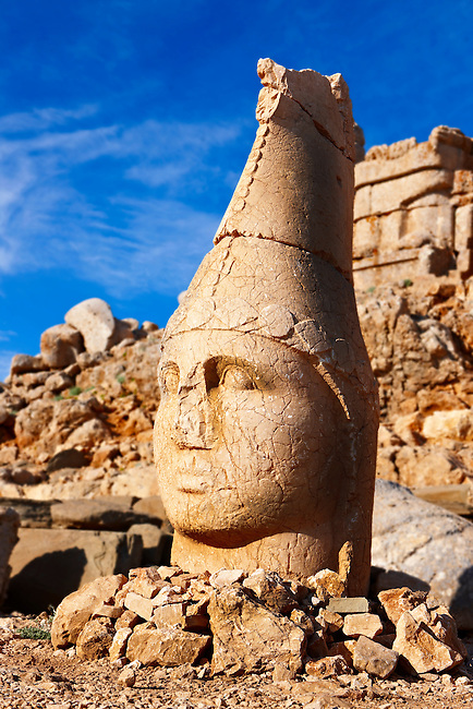 Picture & photo of the statues of around the tomb of Commagene King Antochus 1 on the top of Mount Nemrut, Turkey. Stock photos & Photo art prints. In 62 BC, King Antiochus I Theos of Commagene built on the mountain top a tomb-sanctuary flanked by huge statues (8–9 m/26–30 ft high) of himself, two lions, two eagles and various Greek, Armenian, and Iranian gods. The photos show the broken statues on the  2,134m (7,001ft)  mountain. 3