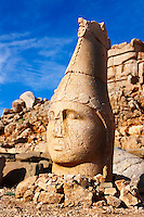 Picture & photo of the statues of around the tomb of Commagene King Antochus 1 on the top of Mount Nemrut, Turkey. Stock photos & Photo art prints. In 62 BC, King Antiochus I Theos of Commagene built on the mountain top a tomb-sanctuary flanked by huge statues (8–9 m/26–30 ft high) of himself, two lions, two eagles and various Greek, Armenian, and Iranian gods. The photos show the broken statues on the  2,134 m (7,001 ft)  mountain. 3