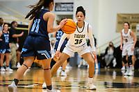 Galatia Andrew (11) of Spring Har-ber brings ball up court Jada Brown (35) of Bentonville pressing at Tiger Arena, Bentonville, AR January 5, 2021 / Special to NWA Democrat-Gazette/ David Beach
