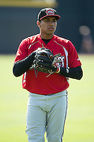 Johan Camargo (2) of the Carolina Mudcats warms up in the outfield prior to the game against the Winston-Salem Dash at BB&T Ballpark on April 22, 2015 in Winston-Salem, North Carolina.  The Dash defeated the Mudcats 4-2..  (Brian Westerholt/Four Seam Images)