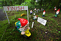 29/05/15<br /> <br /> Scrambling on two wheels.<br /> <br /> For one group of hardy folk, today's rain only adds to the fun that can be had by the beach, fishing in the river, or playing in the woods.<br /> <br /> The gnomes, and a few pixies and fairies, make up a collection, now believed to be close to 2,000 individuals, that 'live' at the Gnome Reserve near Bideford, North Devon.<br /> <br /> Visitors are asked to wear gnome hats, so as not to scare the gnomes who feature as the largest collection in the Guinness Book of World Records. <br /> <br /> Ann Atkin's collection began in 1979 and features traditional gnomes on toad-stools to Olympian athletes, astronauts who work for 'GNASA', a beach scene complete with gnomes in bikinis, a queue for the ice-cream van, Punch and Judy gnomes and another floating on a lilo. Other gnomes can be scene kissing, and flashing their bottoms as the visit the Gents and Ladies toilets. <br /> <br /> <br /> All Rights Reserved - F Stop Press.  www.fstoppress.com. Tel: +44 (0)1335 418629 +44(0)7765 242650
