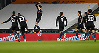 13th March 2021, Craven Cottage, London, England;  Manchester Citys John Stones celebrates after scoring for 0-1 in the 47th minute during the English Premier League match between Fulham and Manchester City at Craven Cottage in London