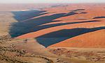 View from Balloon Safari at sunrise near dune fields, Sossusvlei, Namibia.