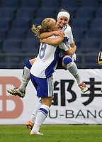 Finland's (8) Leena Puranen and teammate (7) Essi Saino celebrate a goal during the Four Nations Tournament in  Guangzhou, China.  The US defeated Finland, 4-1.