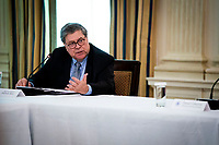 United States Attorney General William P. Barr makes remakes as he participates in a roundtable with law enforcement officials, hosted by US President Donald J. Trump in the State Dining Room of the White House, in Washington, DC, Monday, June, 8, 2020.<br /> Credit: Doug Mills / Pool via CNP/AdMedia
