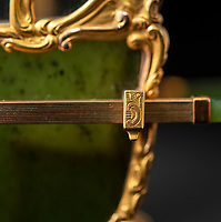 BNPS.co.uk (01202 558833)<br /> Pic: PhilYeomans/BNPS<br /> <br /> Even the tiny pole clamps are detailed...<br /> <br /> In from the cold - Romanov treasure rediscovered in the Cotswolds.<br /> <br /> In from the cold - £500,000 Romanov treasure is hot property at Cotswold auction.<br /> <br /> An exquisite Faberge antique believed to have been made for the Russian Royal family over 100 years ago sold yesterday for a whopping £500,000...over 5 times it's estimate.<br /> <br /> The model of a sedan chair by the iconic Russian jewellers was one of the state treasures seized and sold off by the communist regime following the Russian Revolution.<br /> <br /> It was first sold at high-end Anglo-Russia antique dealers Wartski in London in 1929, where it was bought by a K.W Woollcombe-Boyce for only £75.<br /> <br /> The ornate item, crafted from Jadeite, gold, rock crystal and mother of pearl, has remained in the family ever since and is now being sold by a direct descendant of Mr Woollcombe-Boyce.<br /> <br /> Experts from the Cotswold Auction Company gave the small Russian antique a pre-sale estimate of only £100,000, but always anticipated it could go for much more than that.