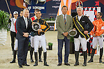 Team magic: Rider Roger-Yves Bost of France and Jockey Joao Moreira of Brazil win the Hong Kong Jockey Club Race of the Riders, part of the Longines Masters of Hong Kong on 10 February 2017 at the Asia World Expo in Hong Kong, China. Photo by Juan Serrano / Power Sport Images