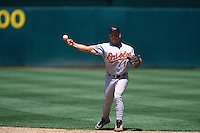 OAKLAND, CA - Roberto Alomar of the Baltimore Orioles in action during a game against the Oakland Athletics at the Oakland Coliseum in Oakland, California on May 13, 1997. Photo by Brad Mangin