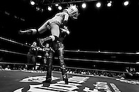 """A female Lucha libre wrestler Princesa Blanca holds her rival over the head during a fight at Arena Mexico in Mexico City, Mexico, 26 April 2011. Lucha libre, literally """"free fight"""" in Spanish, is a unique Mexican sporting event and cultural phenomenon. Based on aerial acrobatics, rapid holds and the use of mysterious masks, Lucha libre features the wrestlers as fictional characters (Good vs. Evil). Women wrestlers, known as luchadoras, often wear bright shiny leotards, black pantyhose or other provocative costumes. Given the popularity of Lucha libre in Mexico, many wrestlers have reached the cult status, showing up in movies or TV shows. However, almost all female fighters are amateur part-time wrestlers or housewives. Passing through the dirty remote areas in the peripheries, listening to the obscene screams from the mainly male audience, these no-name luchadoras fight straight on the street and charge about 10 US dollars for a show. Still, most of the young luchadoras train hard and wrestle virtually anywhere dreaming to escape from the poverty and to become a star worshipped by the modern Mexican society."""