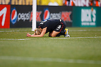 14 MAY 2011: USA Women's National Team midfielder Lindsay Tarpley (5) kneels on the turf after being injured during the International Friendly soccer match between Japan WNT vs USA WNT at Crew Stadium in Columbus, Ohio.