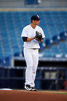 Tampa Yankees starting pitcher James Kaprielian (18) gets ready to deliver a pitch during a game against the Bradenton Marauders on April 11, 2016 at George M. Steinbrenner Field in Tampa, Florida.  Tampa defeated Bradenton 5-2.  (Mike Janes/Four Seam Images)