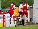 Stirling's Ross Forsyth (left) deflects Jordan White's (9) header into the net to score their third goal.