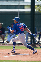 Chicago Cubs third baseman Fidel Mejia (16) follows through on his swing during an Extended Spring Training game against the Los Angeles Angels at Sloan Park on April 14, 2018 in Mesa, Arizona. (Zachary Lucy/Four Seam Images)