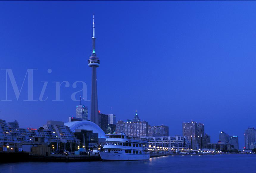 Toronto, Ontario, Canada, Lake Ontario, CN Tower and skyline of downtown Toronto in the evening along Toronto Inner Harbor on Lake Ontario.