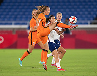 YOKOHAMA, JAPAN - JULY 30: Lynn Wilms #2 of the Netherlands clears the ball away from Tobin Heath #7 of the USWNT during a game between Netherlands and USWNT at International Stadium Yokohama on July 30, 2021 in Yokohama, Japan.