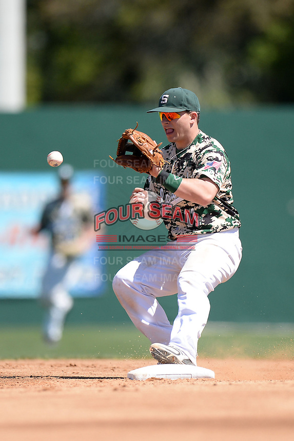 Slippery Rock infielder Jordan Faretta (11) during a game against Kentucky Wesleyan College at Jack Russell Stadium on March 14, 2014 in Clearwater, Florida.  Slippery Rock defeated Kentucky Wesleyan 18-13.  (Mike Janes/Four Seam Images)