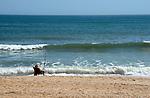 Man fishing from Atlantic Ocean beach
