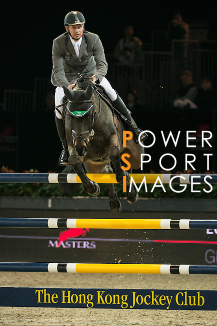 Top international riders compete in the Hong Kong Jockey Club Trophy at the 2014 Longines HK Masters at the Asia World Expo in Hong Kong, China. Photo by Andy Jones / Power Sport Images