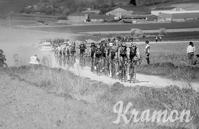 2nd peloton racing over the newly added gravel roads around Ploegsteert, called 'Plugstreets'<br /> <br /> 79th Gent-Wevelgem 2017 (1.UWT)<br /> 1day race: Deinze › Wevelgem - BEL (249km)