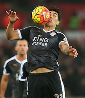 Leonardo Ulloa of Leicester City controls the ball with his face during the Barclays Premier League match between Swansea City and Leicester City played at The Liberty Stadium on 5th December 2015