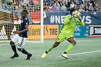 FOXBOROUGH, MA - SEPTEMBER 29: Sean Johnson #1 of New York City FC intercepts a pass intended for Cristian Penilla #70 of New England Revolution during a game between New York City FC and New England Revolution at Gillettes Stadium on September 29, 2019 in Foxborough, Massachusetts.