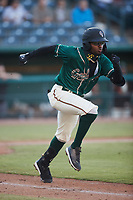 Liover Peguero (10) of the Greensboro Grasshoppers hustles down the first base line against the Hickory Crawdads at First National Bank Field on May 6, 2021 in Greensboro, North Carolina. (Brian Westerholt/Four Seam Images)