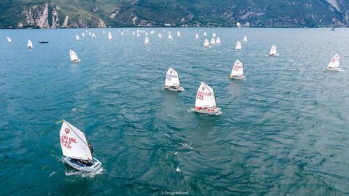 Racing at the 58-nation Optimist Worlds on Lake Garda