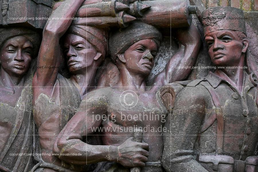 GERMANY, Hamburg, controversial colonial German East-Africa monument, Askari wall relief at former Nazi Lettow-Vorbeck barracks in Jenfeld , Askari is a term for the native african soldiers serving in the colonial troops, display of Askari soldier of the german troop followed by african load carriers , monument designed and established 1938 / DEUTSCHLAND, Hamburg, Germany, Hamburg, Deutsch-Ostafrika-Ehrenmal, Askari Relief im sogenannten Tansania Park auf dem Gelaende der ehemaligen Wehrmacht Kaserne Lettow-Vorbeck in Jenfeld, Askari abgeleitet vom Swahili Wort mit arabischenm Ursprung für Soldat, Bezeichnung für die einheimischen Soldaten oder Polizisten in den Kolonialtruppen, Darstellung eines Askari Soldaten der deutschen Schutztruppe gefolgt von afrikanischen Lastenträgern, geschaffen und aufgestellt 1938 von Bildhauer Walter von Ruckteschell