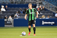 KANSAS CITY, KS - MAY 9: Alex Ring #8 Austin FC with the ball during a game between Austin FC and Sporting Kansas City at Children's Mercy Park on May 9, 2021 in Kansas City, Kansas.