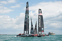 25 July 2015: Land Rover BAR crosses ahead of Oracle Team USA during the America's Cup first round racing off Portsmouth, England (Photo by Rob Munro)
