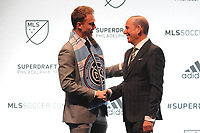 Philadelphia, PA - Thursday January 19, 2018: Jeff Caldwell, Don Garber during the 2018 MLS SuperDraft at the Pennsylvania Convention Center.