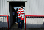 Brentford 0 Doncaster Rovers 1, 27/04/2013. Griffin Park, League One. Griffin Park hosts a showdown between two clubs aiming for automatic promotion from League One. A doncaster supporter stood at the back of the terraced section. Photo by Simon Gill.