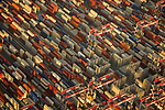 Pictured: This stunning mosaic of colour is actually thousands of containers at The Port of Long Beach in Los Angeles, USA.<br /> <br /> Amazing aerial photos show off the majesty of America's landscape, its architecture, its industry and its wildlife.   From the startling blue potash pools of Utah to hundreds of aircraft sitting unused due to the pandemic, the images display a little seen side of the USA.<br /> <br /> Other images include a passenger plane plane as it touches down in California taken 4,500ft above it, fog over the Golden Gate Bridge and a solar farm in Nevada.   Professor of Music Jassen Todorov, from San Francisco, captured the striking pictures of the American West while flying in a light aircraft.   SEE OUR COPY FOR DETAILS<br /> <br /> Please byline: Jassen Todorov/Solent News<br /> <br /> © Jassen Todorov/Solent News & Photo Agency<br /> UK +44 (0) 2380 458800