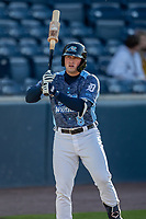 West Michigan Whitecaps third baseman Spencer Torkelson (8) on deck against the Great Lakes Loons at LMCU Ballpark on May 11, 2021 in Comstock Park, Michigan. The Loons defeated the Whitecaps in their home opener 9-1. (Andrew Woolley/Four Seam Images)