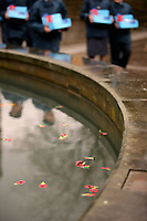 Pictured: Young cadets walk past the poppies placed in the fountain. Saturday 11 November 2017<br />