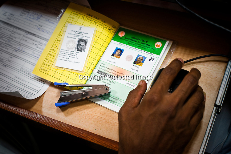 Ration cards and election cards are used as identity proofs during national identity enrollment in Mysore city in Karnataka, India. Photograph: Sanjit Das/Panos