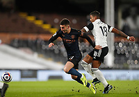 13th March 2021, Craven Cottage, London, England;  Manchester Citys Ferran Torres vies with Fulhams Mario Lemina during the English Premier League match between Fulham and Manchester City at Craven Cottage in London