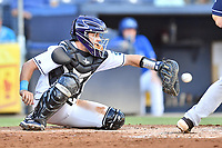 Asheville Tourists catcher Max George (22) awaits the pitch during a game against the Charleston RiverDogs at McCormick Field on August 16, 2019 in Asheville, North Carolina. The Tourists defeated the RiverDogs 12-3. (Tony Farlow/Four Seam Images)