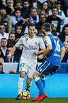 Lucas Vazquez (L) of Real Madrid competes for the ball with Luis Carlos Correia Pinto, Luisinho, of RC Deportivo La Coruna during the La Liga 2017-18 match between Real Madrid and RC Deportivo La Coruna at Santiago Bernabeu Stadium on January 21 2018 in Madrid, Spain. Photo by Diego Gonzalez / Power Sport Images