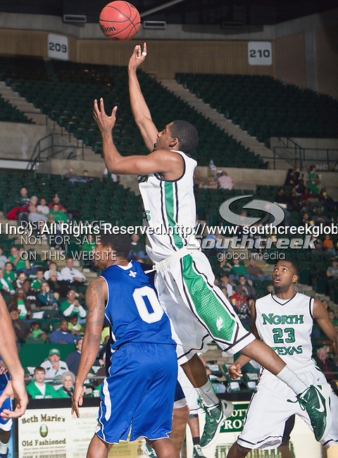 North Texas Mean Green guard Alzee Williams (3) in action during the game between the New Orleans Privateers and the University of North Texas Mean Green at the North Texas Coliseum,the Super Pit, in Denton, Texas. UNT defeated UNO 78 to 47.....