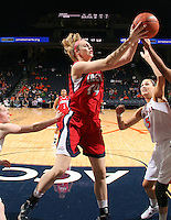 CHARLOTTESVILLE, VA- December 7: Catherine Kearney #44 of the Liberty Lady Flames grabs a rebound next to Erinn Thompson #5 of the Virginia Cavaliers during the game on December 7, 2011 at the John Paul Jones arena in Charlottesville, Va. Virginia defeated Liberty 64-38. (Photo by Andrew Shurtleff/Getty Images) *** Local Caption *** Catherine Kearney;Erinn Thompson